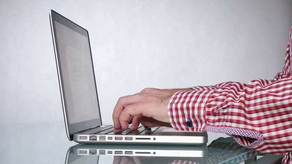 Close-up on man's hands using a laptop Royalty-free stock video