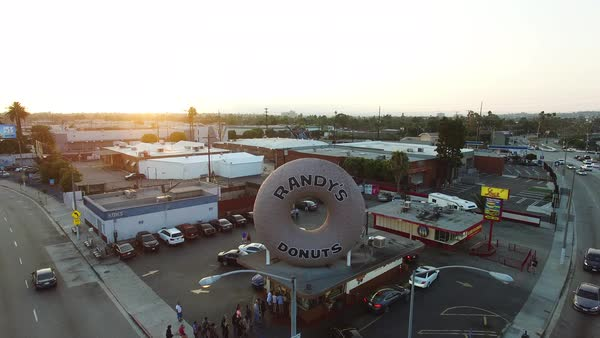 Wide shot of Randy's Donuts bar in Los Angeles CA, USA Royalty-free stock video