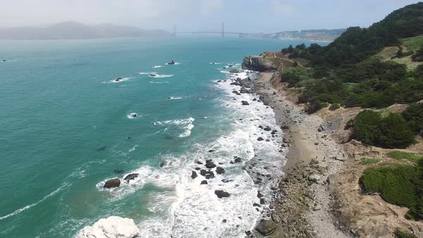 Wide shot of swells and rocky beach at ocean shore in San Francisco CA, USA Royalty-free stock video
