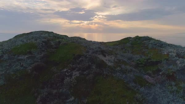 Drone shot of sunset over ocean seen from a shore in California Royalty-free stock video