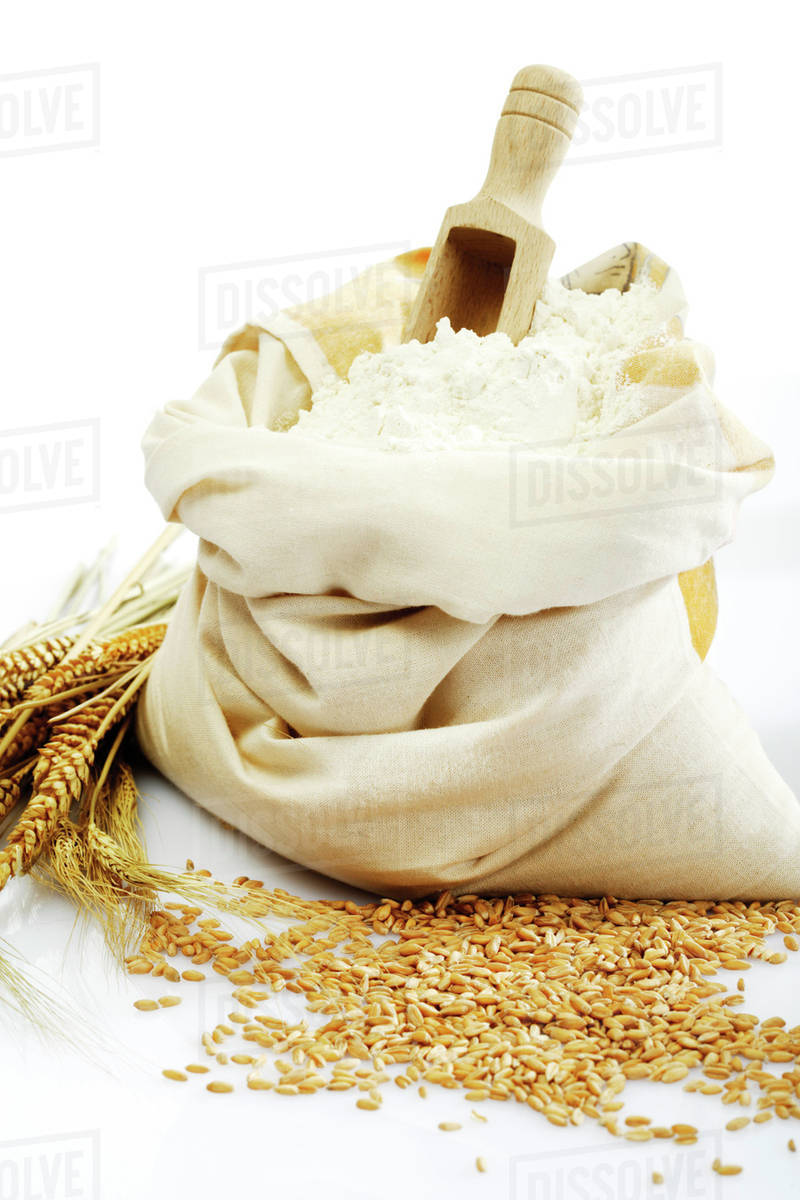 Wheat Ears Grains Crushed Grains And Bag Of Flour Stock Photo