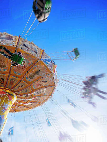 Germany, Hamburg, chairoplane, blurred motion Rights-managed stock photo