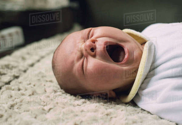 Portrait of yawning baby boy Rights-managed stock photo
