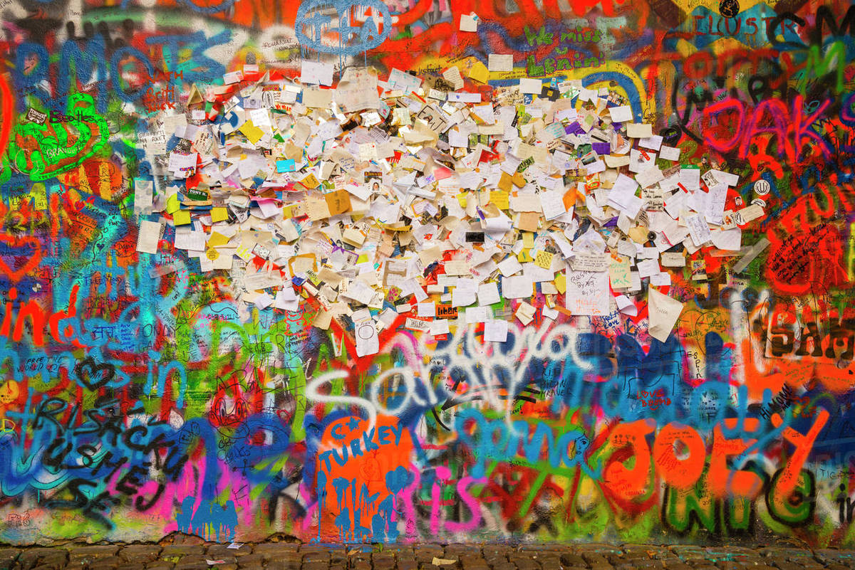 Czechia prague john lennon wall graffitis notes with wishes and pleading