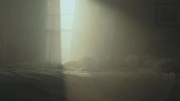 Handheld shot showing sunlight passing through the window of a bedroom Royalty-free stock video