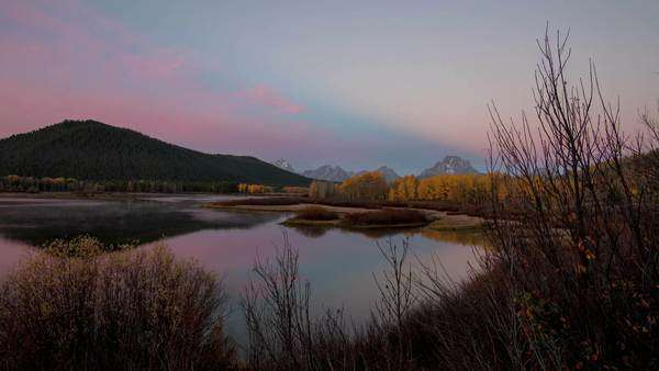 Oxbow Bend with the clouds lighting up at sunrise on a slider. Royalty-free stock video