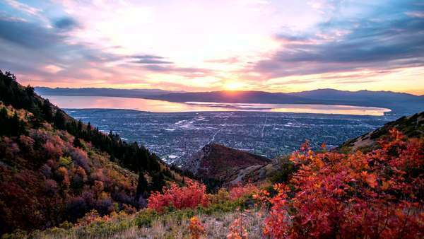 Timelapse of Utah Valley as the sun is setting and the clouds light up over Utah Lake. Royalty-free stock video