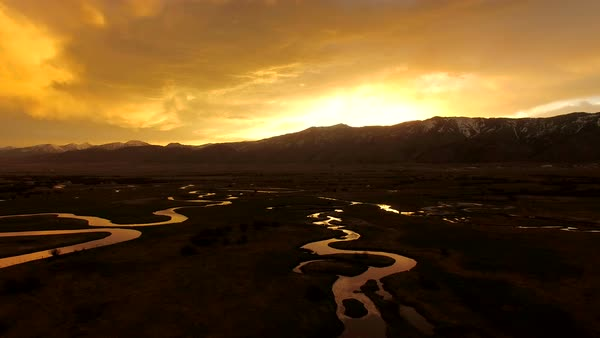 Ariel view of sunrise above winding river in Wyoming Royalty-free stock video