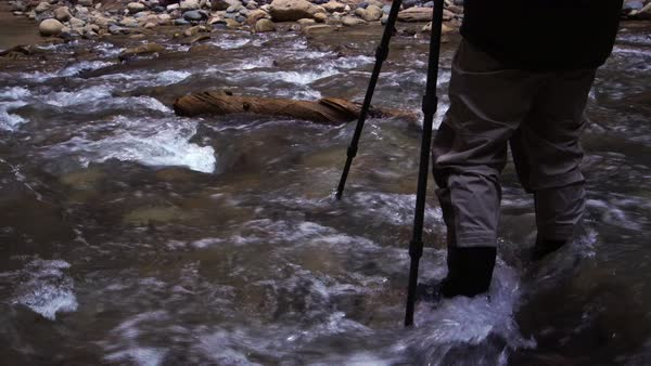 View of photographer standing in river of the Zion Narrows Royalty-free stock video
