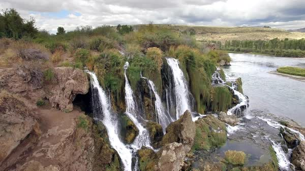 Fall Creek Falls reverse aerial view flowing into Snake River Royalty-free stock video