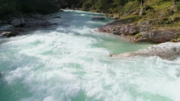 Flying low over the Soca River viewing the rapids and colorful teal water as it flows downstream. Royalty-free stock video