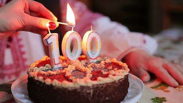 Lighting Candles On Grandmothers 100th Birthday Cake Royalty Free Stock Video