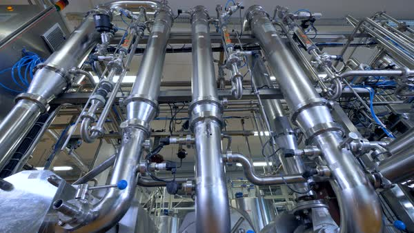 Thick pipes among many thin ones at dairy factory.  Royalty-free stock video