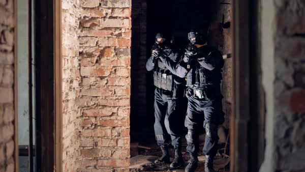 Two swat soldiers explore an abandoned building Royalty-free stock video