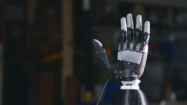 Bionic arm. Innovative robotic hand made on 3D printer. Futuristic technology. Timelapse. Royalty-free stock video