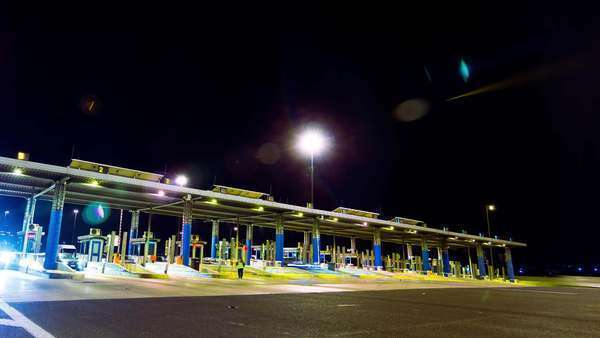 Toll station with cars passing through. Timelapse. Royalty-free stock video