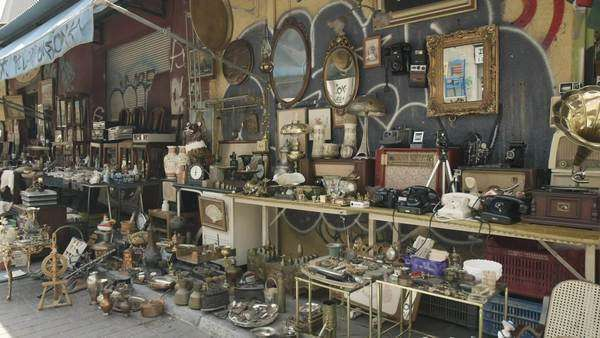 Antiques, old merchandise at the flea market, Monastiraki, Athens, Greece. Outdoor stands with antiques, merchandise, memorabilia and other collector's items for sale, at the public flea market of Monastiraki in Athens, Greece. Royalty-free stock video