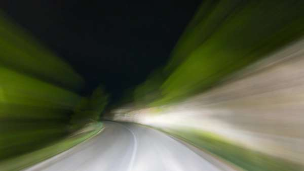 Dark winding mountain road illuminated only by car lights. Camera outside the car mounted at the windshield. Fog kicks in at the end. Royalty-free stock video