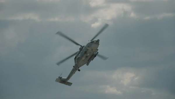 Slow motion shot of a navy helicopter doing various aerobatics. Royalty-free stock video