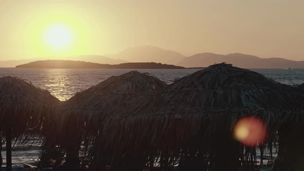 Iconic Greek island beach sunset,umbrellas and chairs Royalty-free stock video