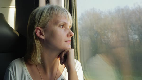 A woman looks out the window of the train Royalty-free stock video