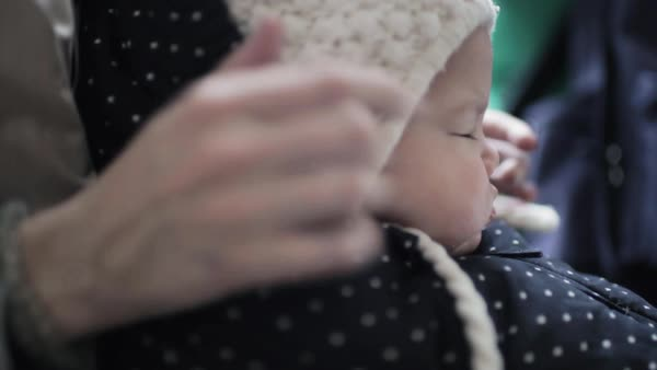 Close-up shot of a mother stroking the face of her baby Royalty-free stock video