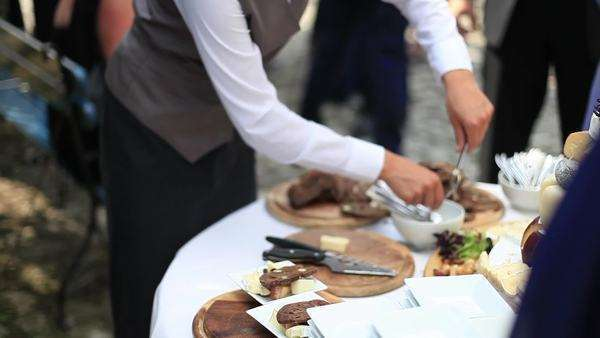 Medium shot of a hostess preparing food on a party Royalty-free stock video