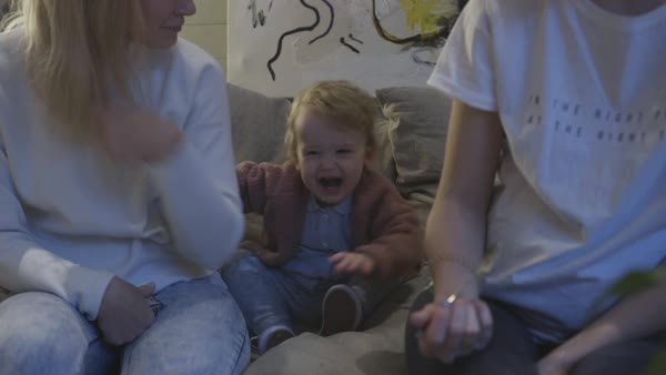 Hand-held shot of a toddler goofing around on a sofa Royalty-free stock video