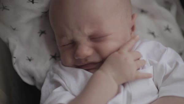 Hand-held shot of a baby having a bad dream Royalty-free stock video