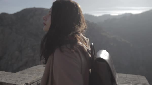 A young woman walking on top of ancient fortress and looking at the view Royalty-free stock video