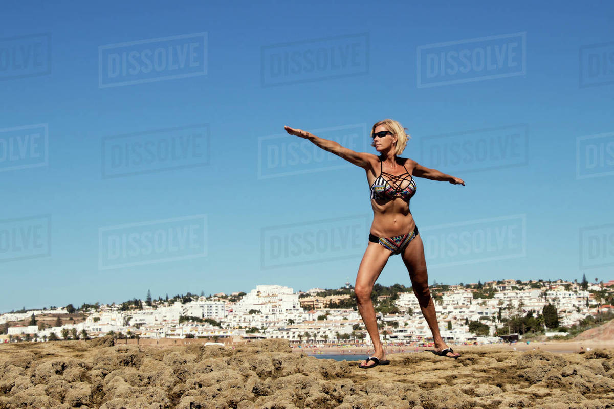 6f9c362918 A Woman Doing Exercise On The Beach Of Luz