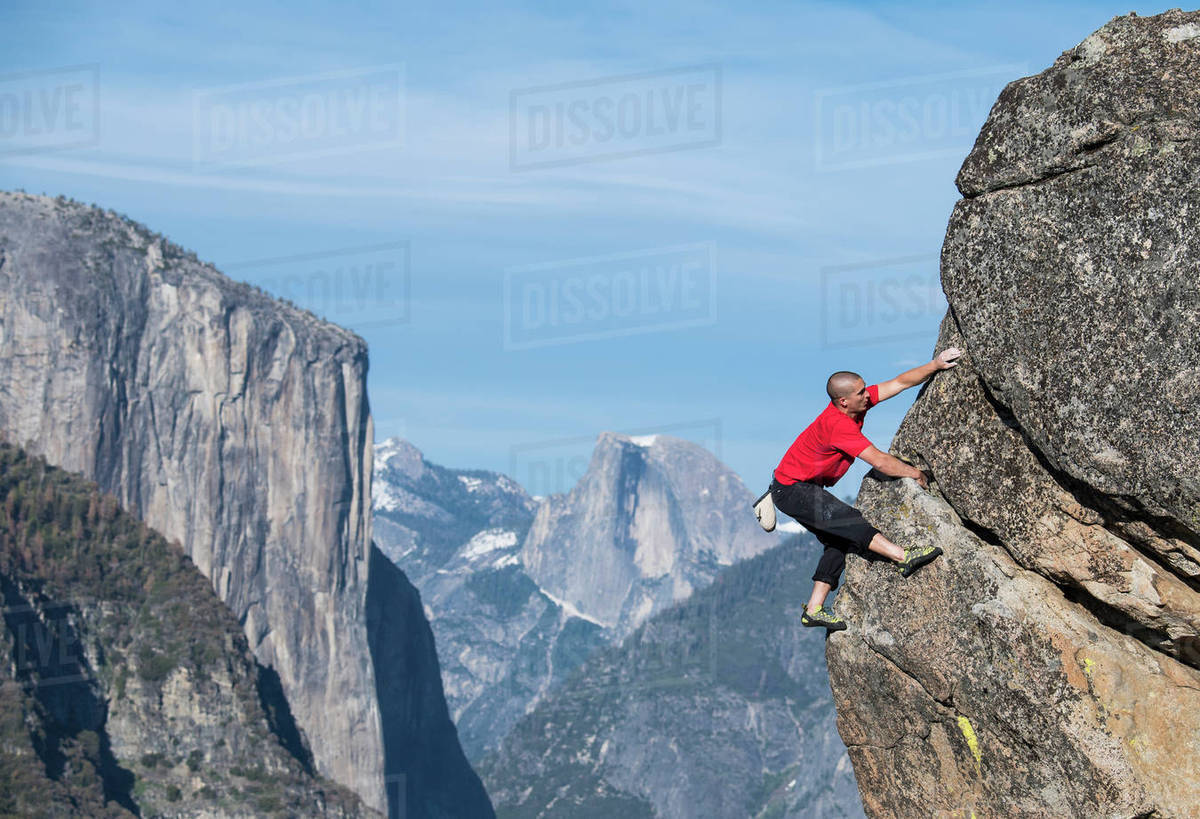 male climber in yosemite with el capitan and half dome in background