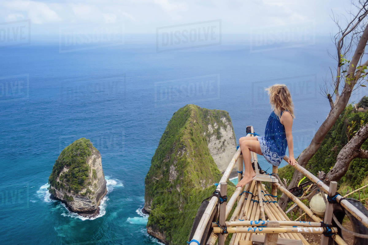 Adult Woman Admiring Coastline Of Nusa Penida Island Bali