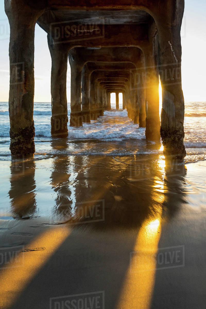 View Underneath Manhattan Beach Pier At Sunset Los Angeles