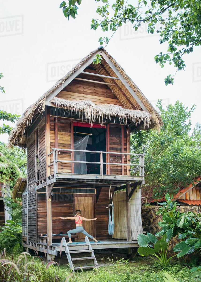Woman Doing Yoga On Porch Of Jungle Hut Tambon Ko Tarutao Chnag