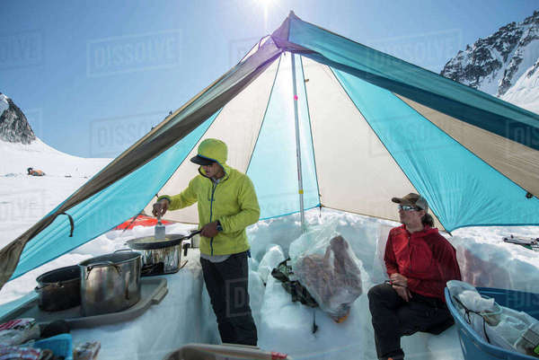 Making breakfast in camp on a glacier in Alaska. Royalty-free stock photo