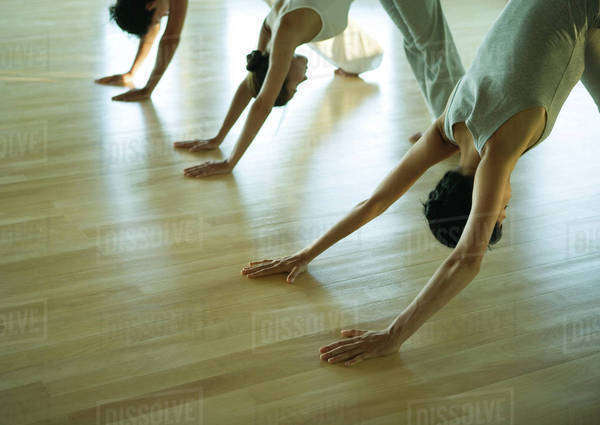 Yoga class in downward facing dog pose Royalty-free stock photo