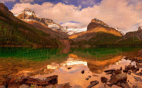 Bright sunlight on an alpine lake Royalty-free stock photo