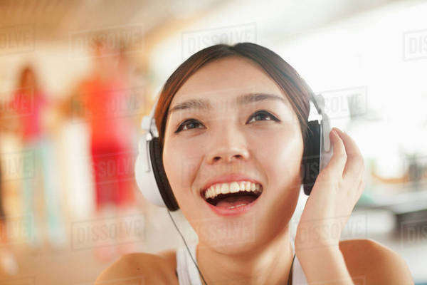 Young women listening to music, portrait Royalty-free stock photo