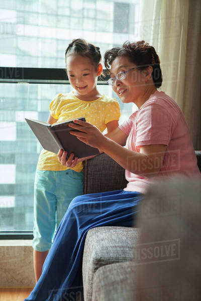 Grandmother reading book to her granddaughter Royalty-free stock photo