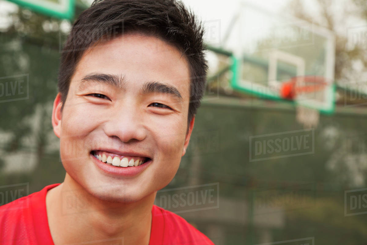Young man on the basketball court, portrait Royalty-free stock photo