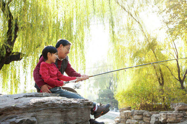Grandfather and grandson fishing portrait at lake Royalty-free stock photo