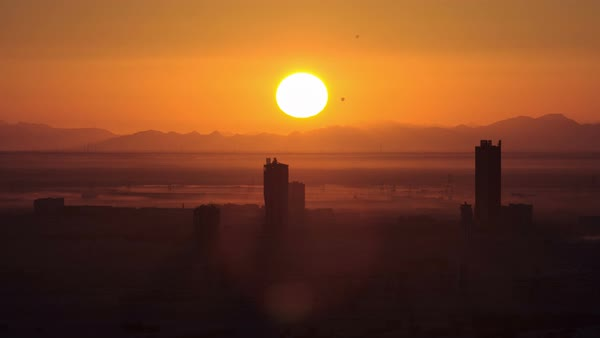 Sunrise in Dubai Marina with buildings, mountains and aerostats from top of skyscrapper, Dubai, UAE timelapse close view Royalty-free stock video