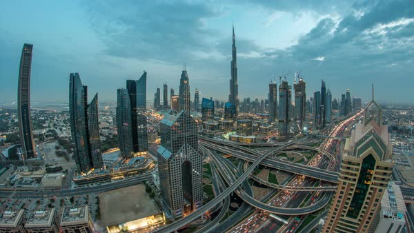 Dubai downtown skyline timelapse at sunset with beautiful city center skyscrapers and Sheikh Zayed road traffic. Top aerial view from tower rooftop. Clouds on the sky. Dubai, United Arab Emirates Royalty-free stock video