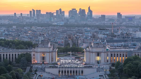 Aerial view over Trocadero day to night transition timelapse with the Palais de Chaillot seen from the Eiffel Tower in Paris, France. Top view from observation deck with modern skyscrapers at summer day Royalty-free stock video