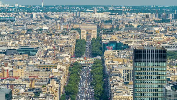 Aerial view of Paris and The Arc de Triomphe with Champs Elysees timelapse from the top of the skyscrapers in Paris business district La Defense. Sunny summer day with blue cloudy sky. Paris, France Royalty-free stock video