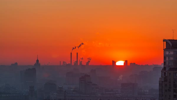 Residential buildings on Leninskiy avenue, Stalin skyscrapers, smoking pipes and panorama of city at sunrise timelapse in Moscow, Russia. Morning mist. Close up. Aerial view from rooftop Royalty-free stock video