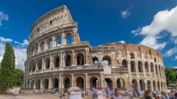 Many tourists visiting The Colosseum or Coliseum timelapse hyperlapse, also known as the Flavian Amphitheatre in Rome, Italy. Cloudy blue sky. Zoom in Royalty-free stock video