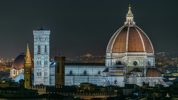 Basilica di Santa Maria del Fiore in Florence at night timelapse - viewed from Piazzale Michelangelo. Evening illumination. Aerial top view Royalty-free stock video
