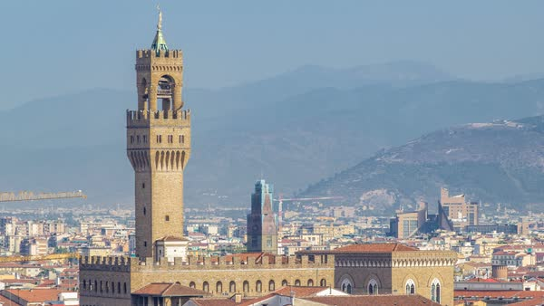 Palazzo Vecchio timelapse on piazza della Signora in the morning as seen from Piazzale Michelangelo. Florence, Italy. Mountains on background. Aerial top view Royalty-free stock video